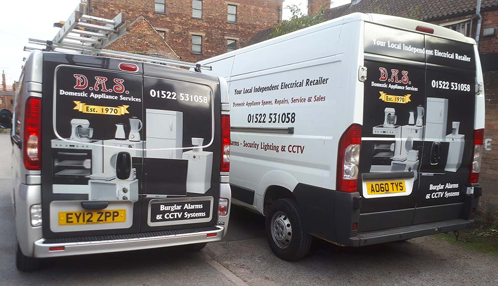 Rear view of 2 DAS Domestic Appliance Services vans parked up on street